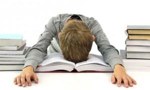 Boy asleep over book